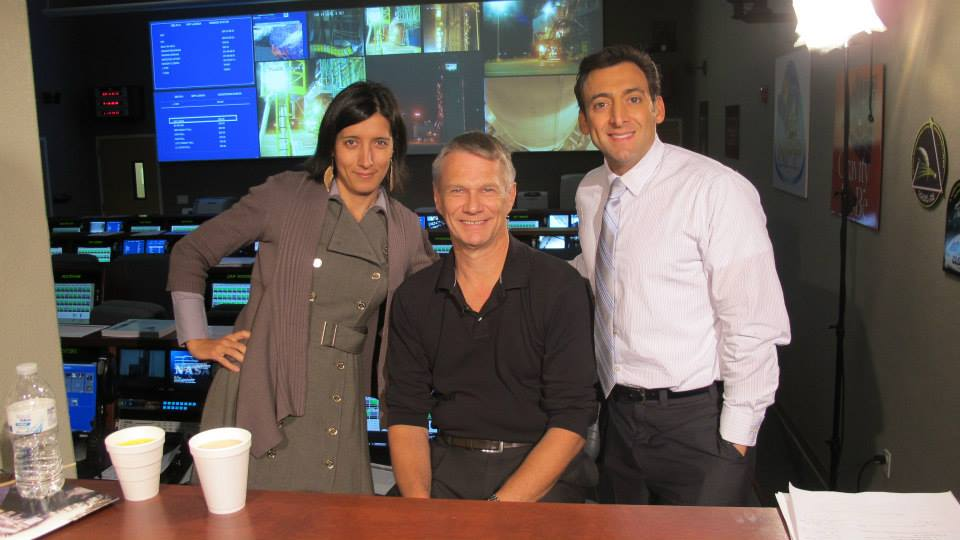 Salsa With Silvia owner Silvia Alexiev during her years as a NASA TV Producer. In this photo Silvia is in mission control for the NASA NPP mission with late astronaut Piers Sellers and reporter Justin Berk