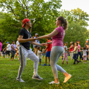Salsa Instructors David and Meghan teach at a family event in Montgomery County. Hire Salsa With Silvia to perform and teach at your event