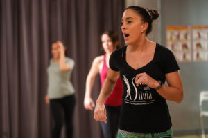 Instructor Kelly teaches salsa dance classes at the Salsa With Silvia dance studio.